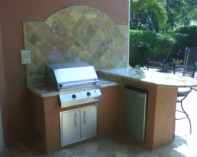 Outdoor kitchen with built in infrared grill and granite counter top