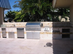 built in dcs gas grill in outdoor kitchen with dish washer and side burner, refrigerator
