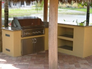 Lynx built in bbq grill in custom grill island and outdoor bar with granite