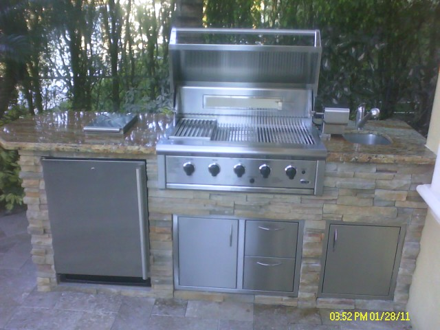 Custom outdoor kitchen with built in bbq grill by outdoor for Built in barbecue grill ideas