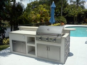 Custom outdoor kitchen with AOG gas grill, ledgestone and granite counter.