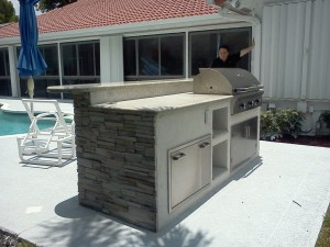 Custom outdoor summer kitchen with built in AOG gas bbq grill