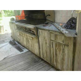 custom grill island made with distressed wood