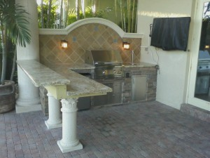 Custom outdoor kitchen with floating bar and backsplash for Granite countertop overhang support requirements