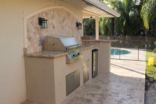Custom Outdoor Kitchen With Granite Counter And Marble