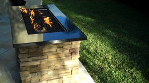 rectangular gas fire pit with fire glass, granite and ledge stone
