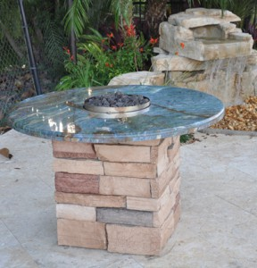 custom gas fire pit matching granite and stone