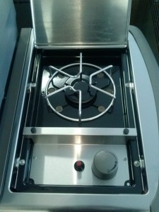 gas side burner range attached to barbecue grill