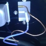 Weber Summit rotisserie burner back showing thermocouple and electrode.