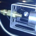 The orifice is threaded into the inside threads of the gas line adaptor supporting the gas hose.