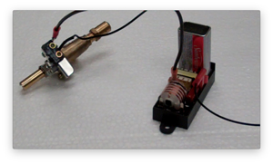 micro switch ignition momentary with button being pressed by using the valve in an automated grill ignitor.