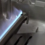 Gas Weber Genesis and Spirit stainless steel pipe burner burning good flame pattern.