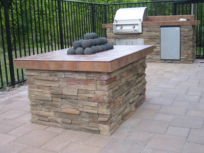 gas fire ball fire pit with custom outdoor kitchen