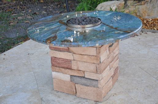 round fire pit with outdoor kitchen