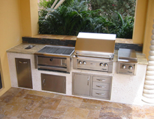 outdoor kitchen image with built in alfresco gas grill coral walls and dry stack ledge stone