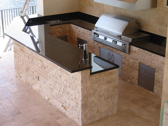 Outdoor kitchen and bar with granite and marble is huge for Pre built outdoor kitchen islands