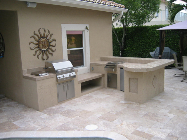 custom outdoor kitchen with tile and stucco with