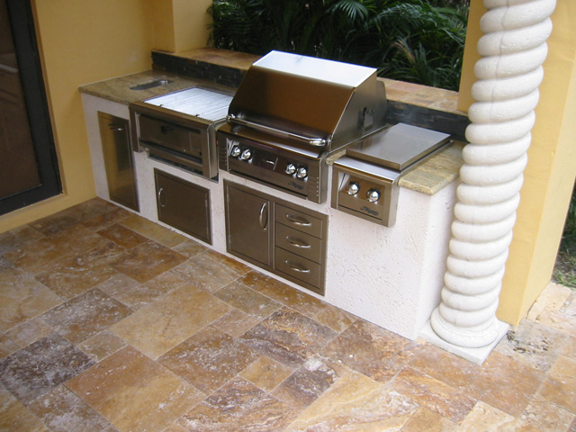 Built In Alfresco Gas Grill Island with Coral walls and a charcal ...