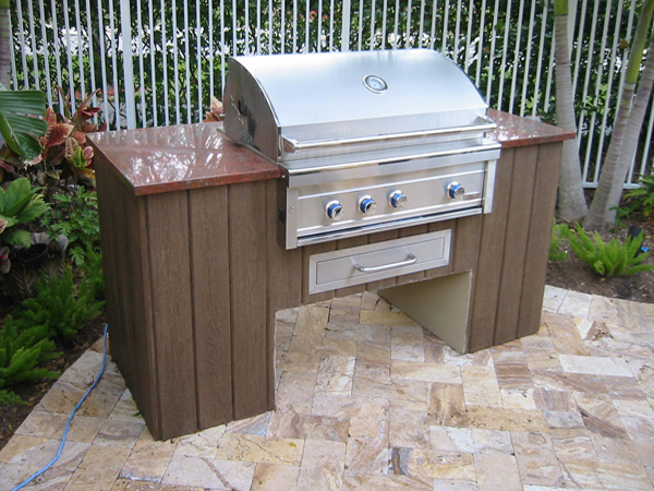 Custom outdoor summer kitchen with granite and faux wood