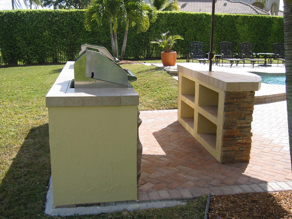 built in aog gas grill island bar side and cubby holes
