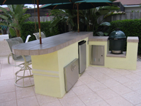 custom outdoor summer kitchen with big green egg