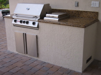 custom outdoor summer kitchen with dcs built in grill and side burner