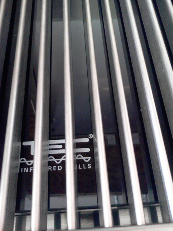 Glass panel for grilling grates on infrared grill